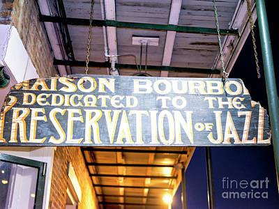 Photograph - Maison Bourbon Jazz Club New Orleans At Night by John Rizzuto