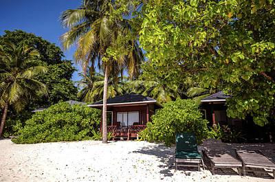 Photograph - Maldivian Resort Huts by Jenny Rainbow