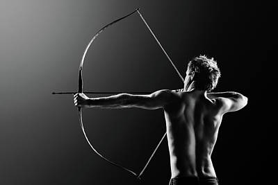 Shooting Wall Art - Photograph - Male Archer Drawing Long Bow by Johan Swanepoel