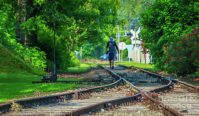 Photograph - Man And Squirrel On Tracks by Tom Claud