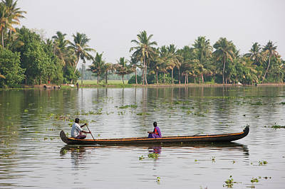 Kerala Photograph - Man And Woman In Traditional Canoe by Martin Child
