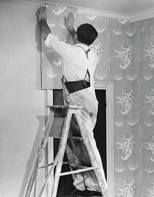 House Photograph - Man Applying Wallpaper by George Marks