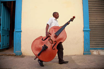 Photograph - Man Carrying Bass To Gig by Grant Faint