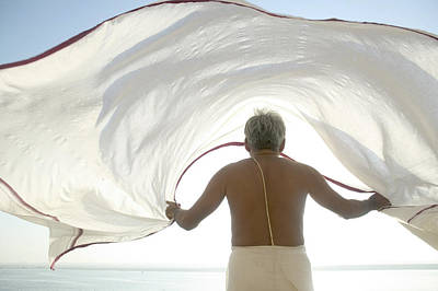 Ganges Photograph - Man Dries His Lungi In The Winds By The by Gavin Quirke