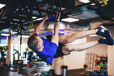 Photograph - Man Exercising On A Rig At The Gym. by Michal Bednarek