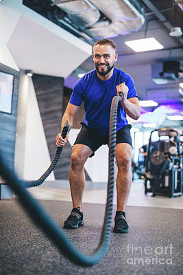 Photograph - Man Exercising With Ropes At The Gym. by Michal Bednarek