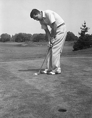 Photograph - Man Golfing by George Marks