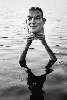 Photograph - Man Holding Plaster Head Above Water B&w by Alfred Gescheidt