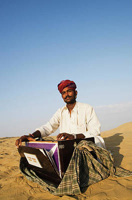 Photograph - Man Playing A Harmonium In A Desert by Exotica.im
