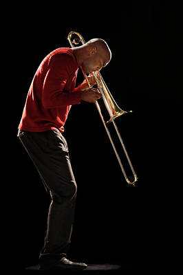 Photograph - Man Playing Trombone, Side View by Moodboard