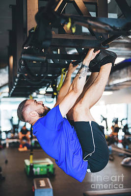 Photograph - Man Pulling His Body Up On The Rig At The Gym. by Michal Bednarek