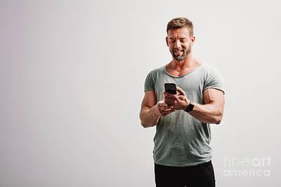 Travel - Man using his smartphone smiling by Michal Bednarek
