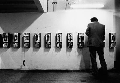 Rear View Photograph - Man Using Public Telephone,grand by Eric Larrayadieu