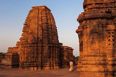 Karnataka Photograph - Man Walking At Sunset In Pattadakal by Marji Lang