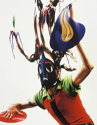 Photograph - Man Wearing A Mask And Holding Colorful by Hassan Jarane