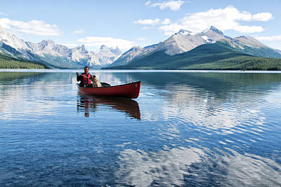 Photograph - Man With Dog Canoeing On Maligne Lake by S-eyerkaufer