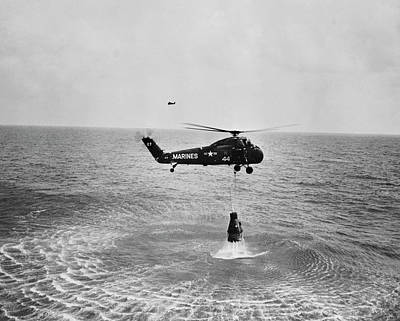Holding Photograph - Marine Helicopter Lifting The Astronaut by Superstock