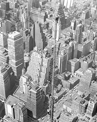 Photograph - Men Perched Atop The Empire State by New York Daily News Archive