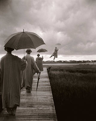 Holding Photograph - Men With Umbrellas Flying  Into Sky by Bryce Lankard