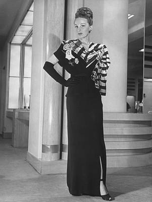 Photograph - Model Displaying Evening Dress At Nieman by Nina Leen