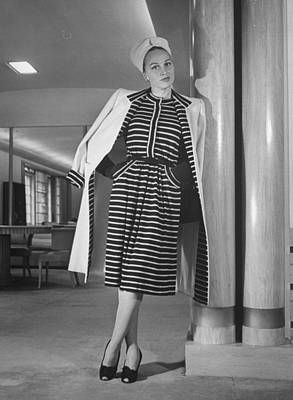 Photograph - Model Wearing Dress And Coat Ensemble by Nina Leen