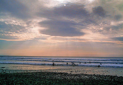 Photograph - Moody Autumnal Sky Over Surfers At Crooklets Bude Cornwall by Richard Brookes