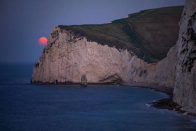 On Trend At The Pool - Moonset at Durdle Door in England. by George Afostovremea