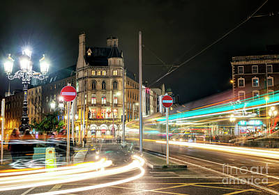 Photograph - Motion On The O'connell Bridge At Night Dublin by John Rizzuto