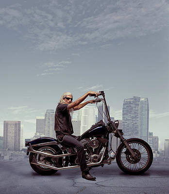 Photograph - Motorcycle Rider With City Background by Ed Freeman