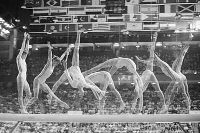 Photograph - Multiple Exposure Of Nadia Comaneci On by Bettmann