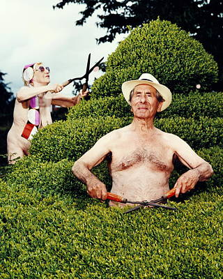 Naked Photograph - Naked Mature Couple Trimming Hedge, Man by Chris Craymer