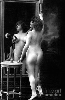 Photograph - Naked Woman Posing In Front Of A Mirror Near A Pedestal Table, 1913 by French School