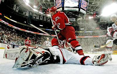 Photograph - New Jersey Devils V Carolina Hurricanes by Bruce Bennett