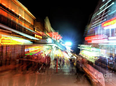 Photograph - New Orleans Motion On Bourbon Street At Night by John Rizzuto