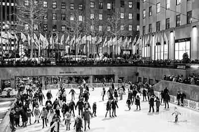 Photograph - Night Skating At Rockefeller Center by John Rizzuto