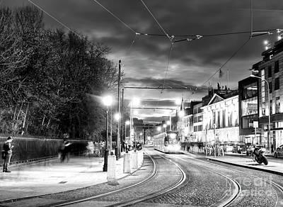 Photograph - Night Tram In Dublin by John Rizzuto