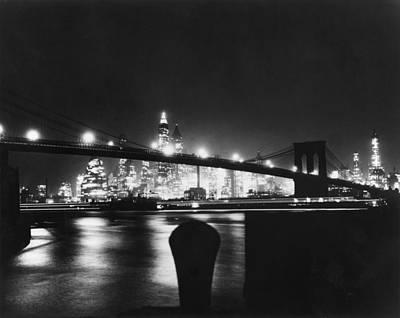 Photograph - Night View Of Brooklyn Bridge by Bettmann