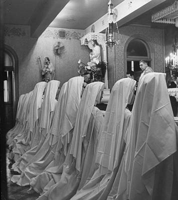 The Bronx Photograph - Nuns Of The Carmelite Order Praying To T by Nina Leen