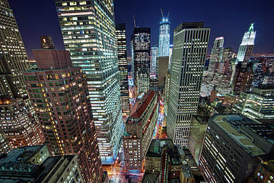 Photograph - Nyc Skyscrapers Light Up By Night by Jason Pierce Photography (jasonpiercephotography.com)