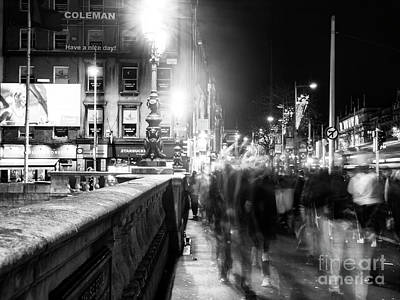 Photograph - O'connell Bridge Crowds At Night Dublin by John Rizzuto