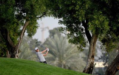 Photograph - Omega Dubai Desert Classic - Day One by Ross Kinnaird