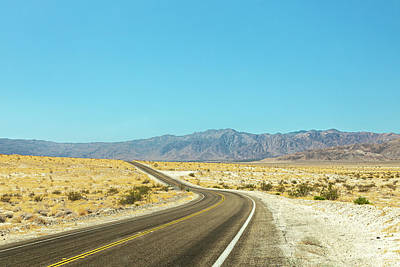 Royalty-Free and Rights-Managed Images - On a Dark Desert Highway II by Peter Tellone