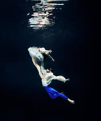 Photograph - Pair Of Ballet Dancer Underwater by Henrik Sorensen