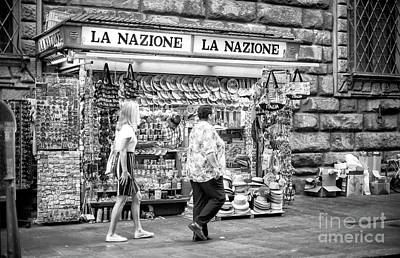 Photograph - Past The Newsstand In Florence by John Rizzuto