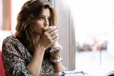 Thomas Kinkade - Pensive woman drinking coffee by Wdnet Studio