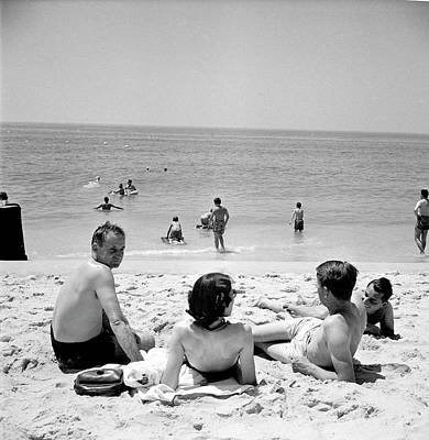 Photograph - People Enjoying A Day At The Beach On by Alfred Eisenstaedt