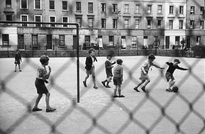 Photograph - Playing Football by Thurston Hopkins