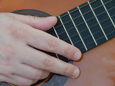 Classical Wall Art - Photograph - Playing Hands On Guitar Music by Oleg Prokopenko