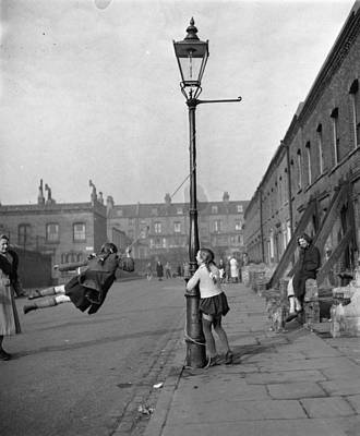 Child Photograph - Playing In Street by Haywood Magee