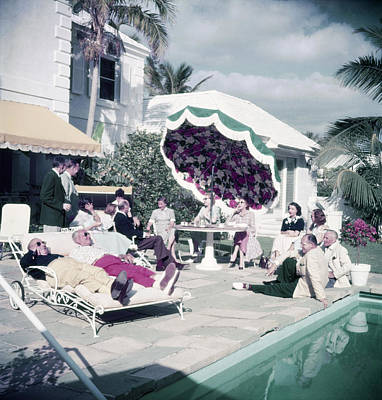 Gulf Coast Photograph - Poolside Party by Slim Aarons